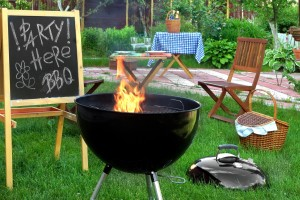Backyard BBQ Grill Party Scene.Chalkboard With Sign Party Here BBQ Flaming Grill Wood Outdoor Furniture Garden Decoration Wine Picnic Basket