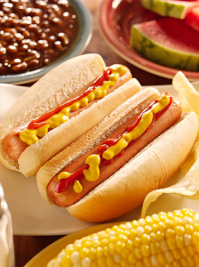 hot dog meal with onion, ketchup and mustard as topping